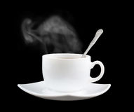 White cup of fresh tea or coffee with vapor Stock Image