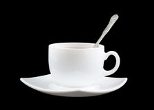 White cup of fresh tea with spoon and saucer Royalty Free Stock Photography