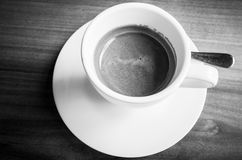 White cup of freshly brewed espresso coffee Stock Image