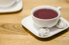 A white cup of fruit tea royalty free stock images