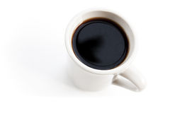White cup full of black coffee stands on the table Stock Images