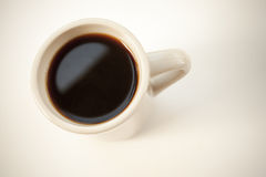 White cup full of black coffee stands on the table Stock Photos