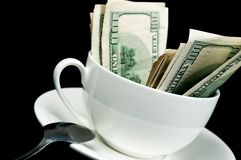 White cup full of dollars Royalty Free Stock Images