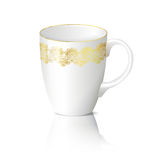 White cup with gold ornaments with reflection Royalty Free Stock Photo