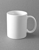 White cup on gray background. Royalty Free Stock Photo