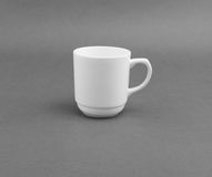 White cup on gray background. Royalty Free Stock Photography