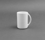 White cup on gray background. Stock Image