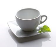 White cup with green leaf Royalty Free Stock Photo