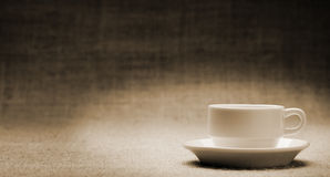 White cup on grunge a background Stock Photo