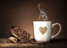 White cup with heart and coffee beans Royalty Free Stock Images