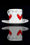 White cup with hearts. Stock Photos