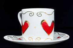 White cup with hearts. Royalty Free Stock Photos