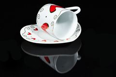 White cup with hearts. Royalty Free Stock Photography