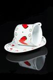 White cup with hearts. Stock Images
