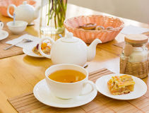 Herbal tea and a piece of cake on a saucer Royalty Free Stock Photos
