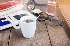 White cup hot black coffee on wood table with working women thin Stock Photos