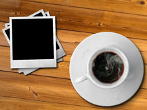 White cup of hot coffe and photo frame Royalty Free Stock Photos