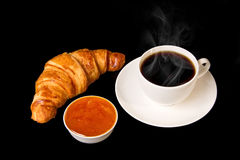 White cup of hot coffee with french croissant Stock Image