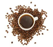 White cup of hot coffee and grains Royalty Free Stock Photos
