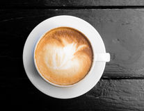 White cup of hot coffee latte Royalty Free Stock Image