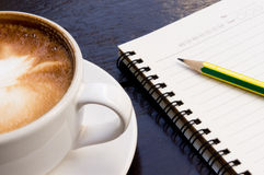 White cup of hot coffee latte Royalty Free Stock Images