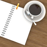 White cup of hot coffee and white sketch book Stock Photography