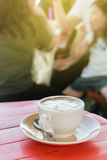 White cup of hot coffee on wood table in coffee shop Royalty Free Stock Photography