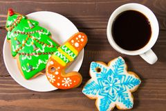 White Cup with hot drink and christmas gingerbread. On wooden brown background .The view from the top Stock Image
