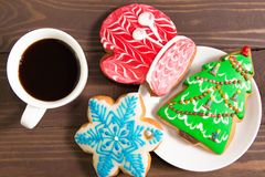 White Cup with hot drink and christmas gingerbread on wooden bro. Wn background .The view from the top Stock Image