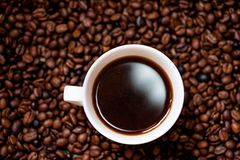 White cup of hot, fresh and aromatic coffee, detail view Royalty Free Stock Images