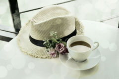 White cup of hot tea and Straw Hat  with vintage style Royalty Free Stock Photography