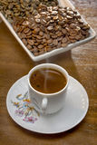 White cup hot  Turkish coffee  and scattered coffee grains Royalty Free Stock Photos