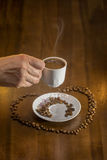 White cup hot  Turkish coffee  and scattered coffee grains Royalty Free Stock Image