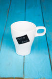 White cup with the inscription coffee time Royalty Free Stock Images