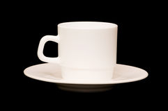 White cup isolated on the black Royalty Free Stock Image