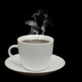 White cup isolated on black background Stock Photography