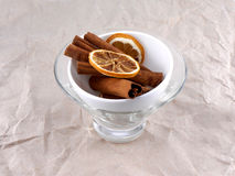 White Cup with lemon and cinnamon bark Stock Images