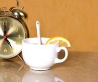 White cup of tea with lemon Stock Photos
