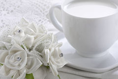 White Cup of Milk and Roses stock images