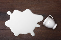 White cup and milk splash Royalty Free Stock Photography