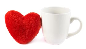 White cup next to a red heart Royalty Free Stock Photography