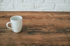 Kitchen. A cup on a wooden chair stock photography
