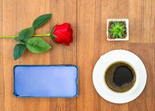 White Cup Of Coffee And Red Rose With Cellphone Valentine Concept Royalty Free Stock Images