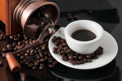 White cup with old Neapolitan grinder coffee Stock Images