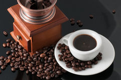 White cup with old Neapolitan grinder coffee Royalty Free Stock Photo