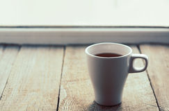 White cup on old wooden table. Horizontal format. Royalty Free Stock Photo