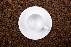 White cup over coffee bean made background Royalty Free Stock Images