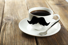 White cup with paper mustache Stock Photo