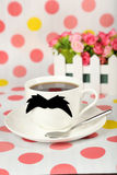 White cup with paper mustache on colorful background Stock Images
