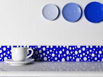 A white cup and a plate on the table Stock Images